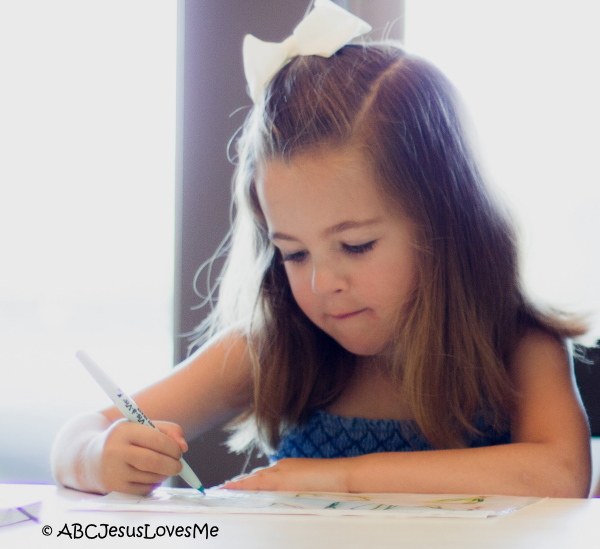 Child writing letters.