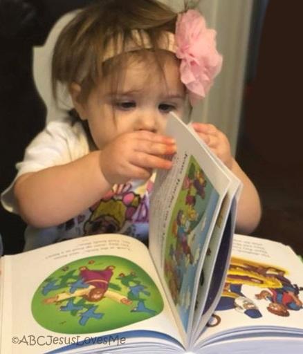 Child reading a children's Bible