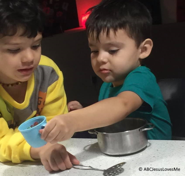 Children cooking together.