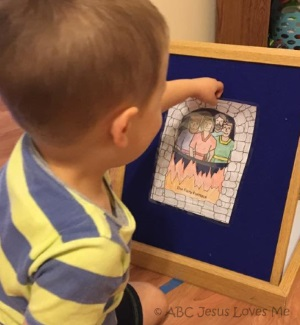 Child playing with Bible flannelgraph.