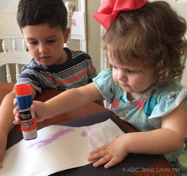 Two preschool children doing crafts together.