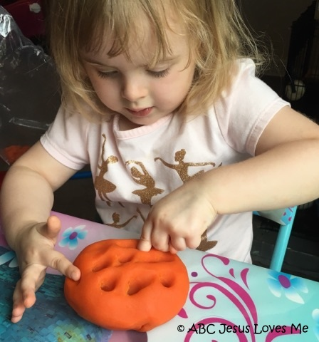 Child playing with play dough.