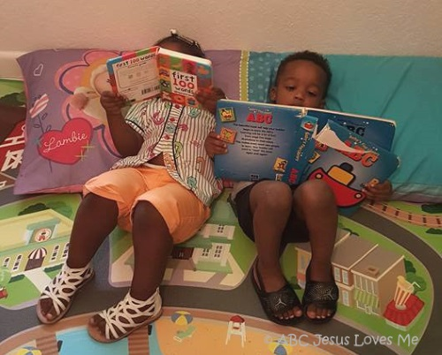 Children reading together on the floor.